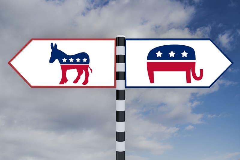 Foto de una señal con los símbolos de los republicanos y demócratas.