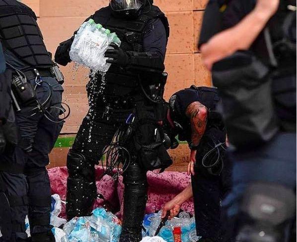 Coalicíon de de justicia racial Asheville policía