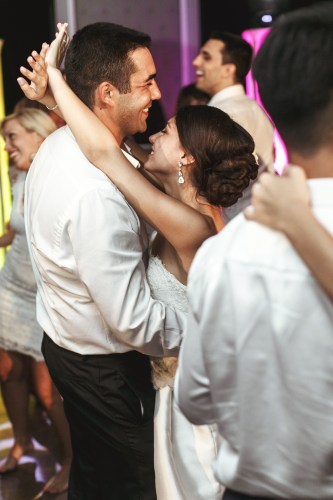 Romantic married couple bride and groom dancing at wedding recep