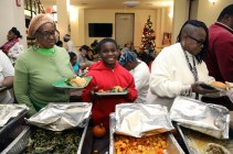 Families are served a Thanksgiving meal at Lantern Community Services