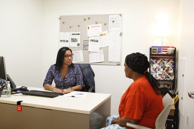 A Lantern Program Director talks to a resident in her office