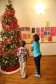 Children look at the Christmas tree at Lantern Community Services