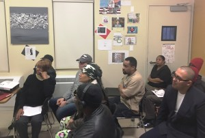Audience watches Rustin House's Black History Month Open Mic