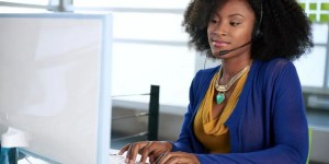 image of sales lady sitting at her computer
