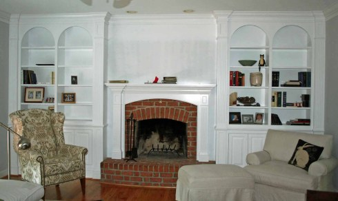 Residential Painted Bookcase And Fireplace Surround