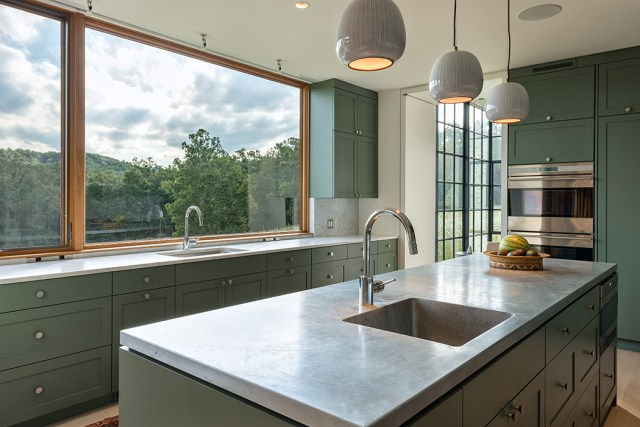 The kitchen features cabinets by Lantz Custom Woodworking. Photo: Stephen Barling