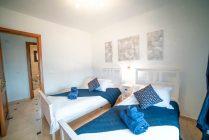 Dormitorio-planta-baja-camas-separada-02
