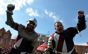 US knights react after loosing against Poland in the 16 vs16 competition of the Medieval Combat World Championship at Malbork Castle on May 3, 2015. AFP PHOTO/JANEK SKARZYNSKI