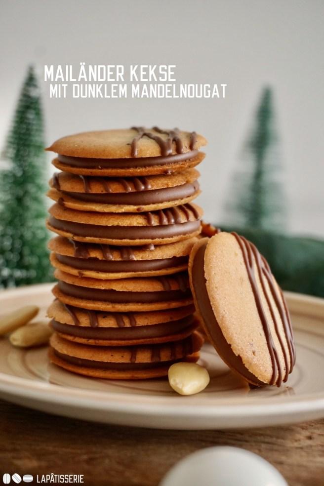 In der Weihnachtsbäckerei gibt es feine, knusprige Mailänder Kekse gefüllt mit zartschmelzendem, dunklem Mandelnougat.