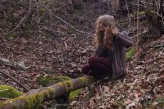 Krii plays the fallen tree