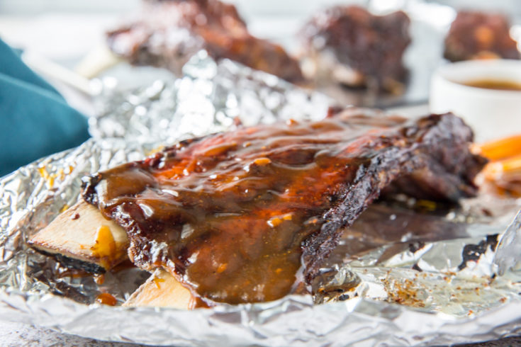 easy instant pot beef ribs on aluminum foil with low carb BBQ sauce