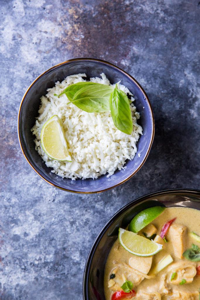 riced cauliflower in a bowl with thai green curry