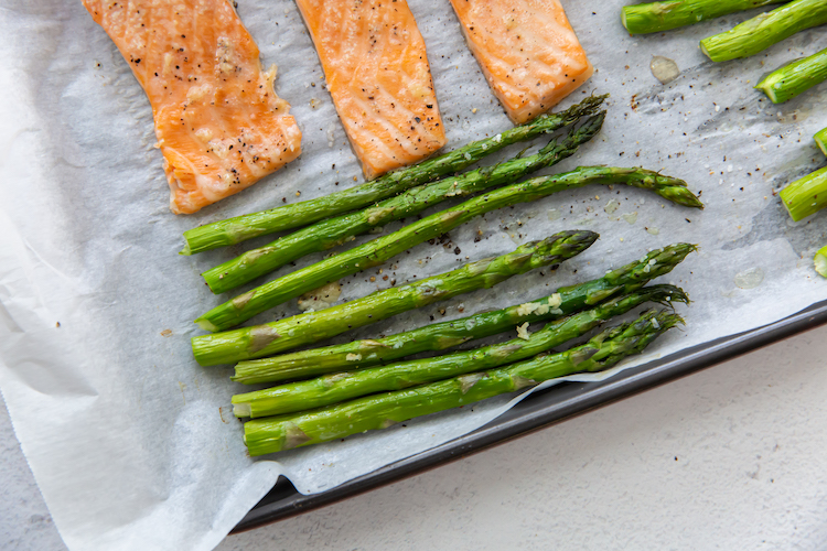 close up image of baked asparagus and salmon