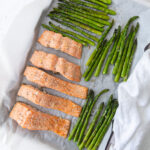 baked salmon and asparagus and a white cloth napkin