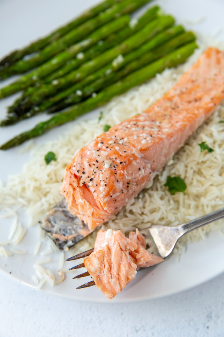 baked salmon with a fork bite taken out