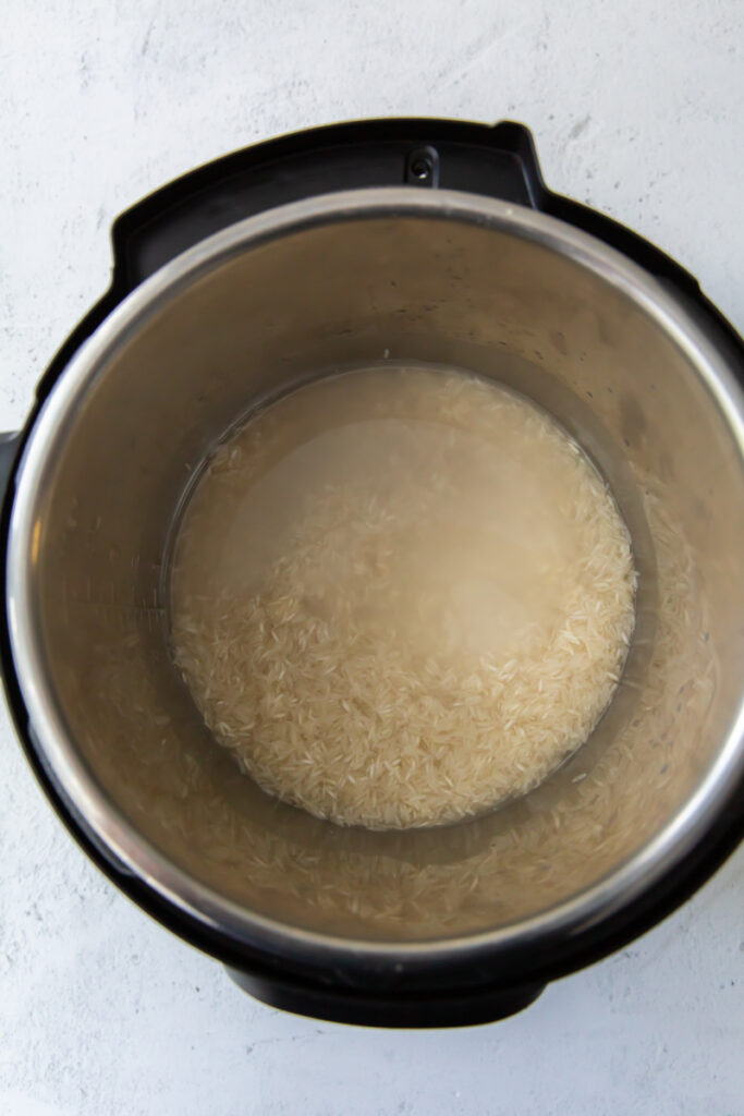 salt, water and rice in an instant pot