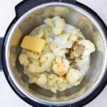 cauliflower, butter, cream and seasonings inside an instant pot