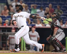 The Miami Marlins' Marcell Ozuna flies out in the fourth inning against the Arizona Diamondbacks on Friday, Aug. 15, 2014, at Marlins Park in Miami. The Diamondbacks won, 3-2. (David Santiago/El Nuevo Herald/MCT via Getty Images)