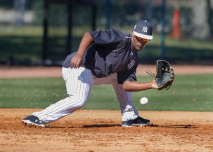 Feb 20, 2017; Tampa, FL, USA; New York Yankees third baseman Miguel Andujar (94) catches a groin ball during MLB spring training workouts at George M. Steinbrenner Field. Mandatory Credit: Reinhold Matay-USA TODAY Sports