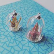 Mini origami in dome/or globe. Shown with silver plated casing.