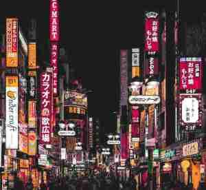 people walking down street in Tokyo
