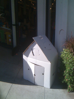 small, white cardboard house