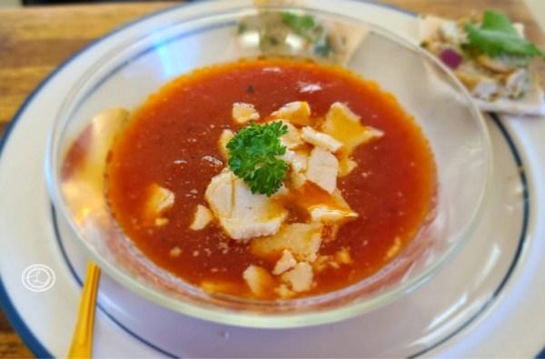 Soup with broken Garlic Cracker pieces