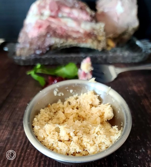 Homemade Horseradish in a small bowl with Prime Rib Roast in the background