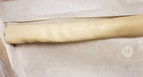 Rolled dough into a log