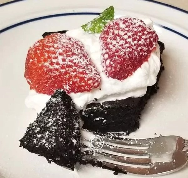 Slice of Cake on a plate with a bite on a fork