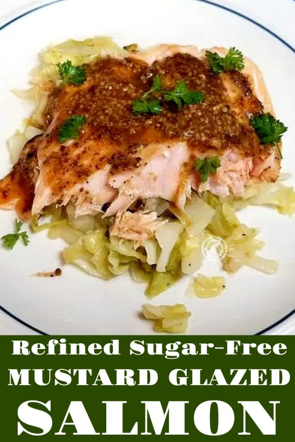 Mustard Glazed Salmon on top of a bed of cabbage with glaze and parsley