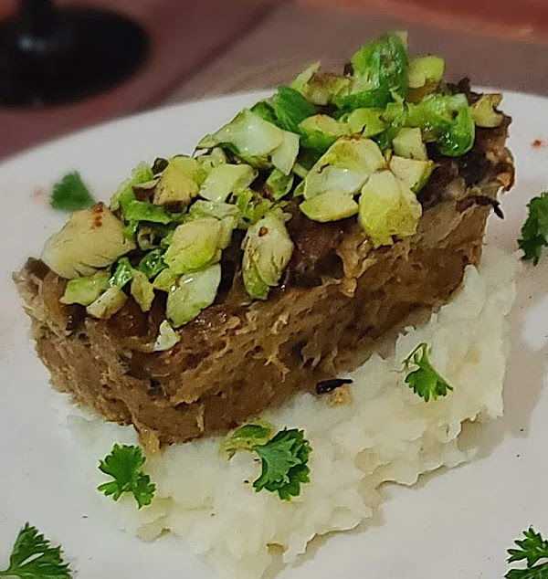 A picture of Swedish American Meatloaf on top of cauliflower mash