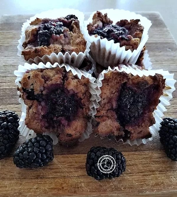 Stack of cooked muffins and blackberries