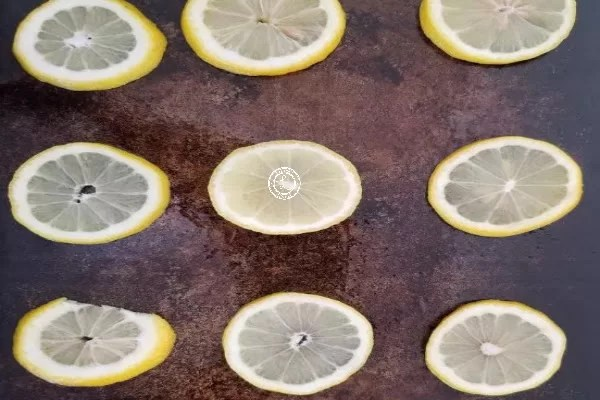 Sliced lemons on a baking sheet
