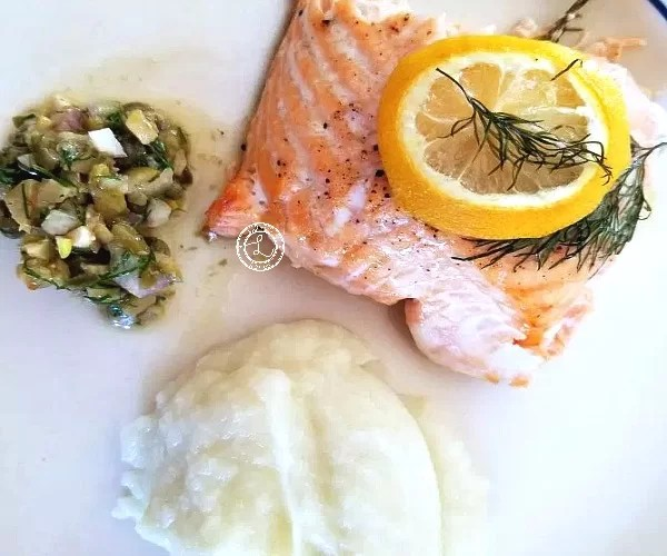 Dinner plate with Cooked salmon, cauliflower mash and Keto Caper Dill Sauce