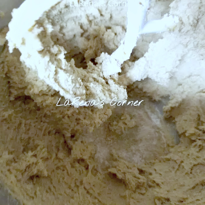 Blending sugar, cream cheese, vanilla and butter