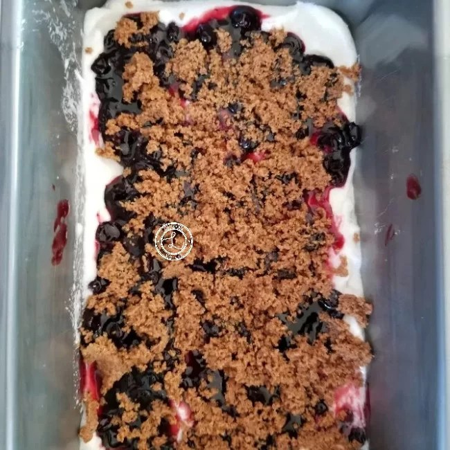 Cheesecake ice cream, huckleberry sauce, graham cracker crust crumbs.
