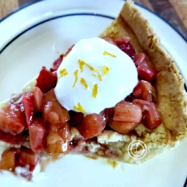 Strawberry and Rhubarb Custard Pie with whipped coconut cream and lemon zest