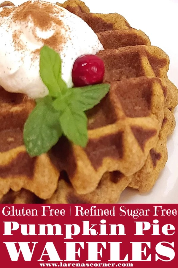 2 Pumpkin Pie Waffles on a plate with whipped cream, cinnamon, a cranberry, and a sprig of mint
