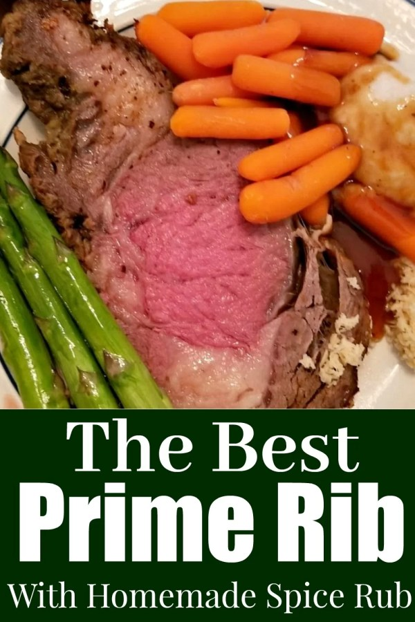 Prime Rib on a plate with Carrots and asparagus