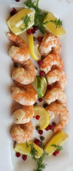 Cooked Lemon Dill Shrimp on a platter