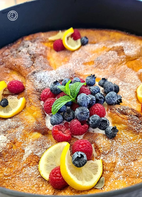 Dutch Pancake in a Iron Skillet with fresh fruit