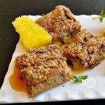 Pineapple Pancake Bars with Pineapple Apple Syrup a pineapple slice and mint sprigs