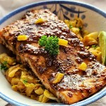 Mustard Glazed Salmon on a bed of Mustard Caraway Fried Cabbage on a bowl