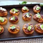 A baking stone with Cheesy BBQ Sweet Potatoes