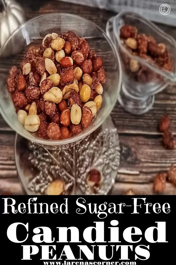 Refined Sugar-Free Candied Peanuts in a bowl and in a syrup server. With candied peanuts and a pumpkin candle to decorate.