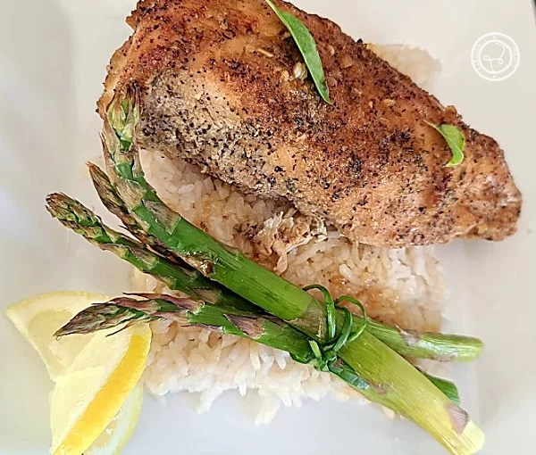 Garlic Lemon Chicken with rice and asparagus.