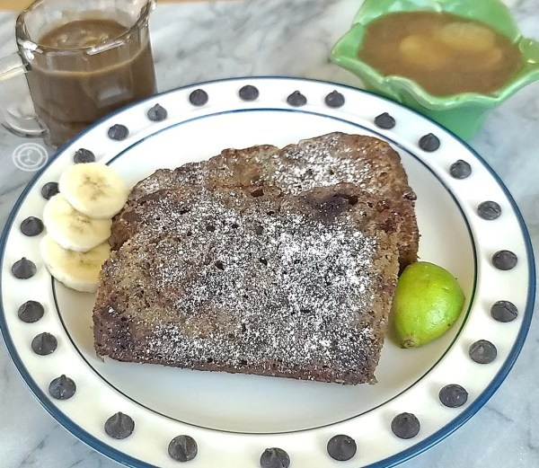 French Toast on a plate surrounded by chocolate chips