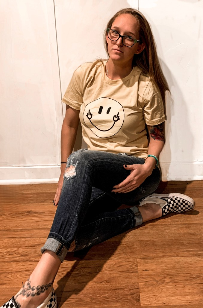 Girl with smile tshirt - smile in the face of chronic pain