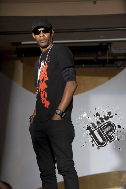 Mr. Lexx flexing in RepJA at Caribbean Fashion Rocks